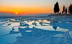 """*TURKEY ~ At Pamukkale,in Denizli Province in southwestern Turkey,the seep of hot-spring water over millennia has created a """"white castle"""" of terraced travertine pools+one of the most spectacular landscapes you'll find anywhere. Its beauty was recognized early on;Pamukkale has served as a spa site for at least 2,200 years.The Greco-Roman town of Hierapolis was established above the pools+its ruins temples, bathhouses, a theater+more,remain."""