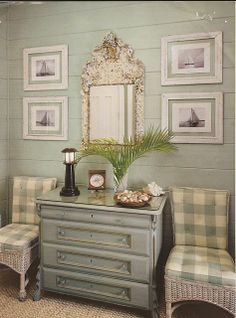 Palest blue wood walls, oyster shell mirror, black and white sailboat photographs, buffalo check, sisal