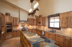 Ranch style house in New Mexico, outside of Santa Fe. Beautiful rustic feel with wood accents, top end finishes and fiber art decoration #wallhanngings