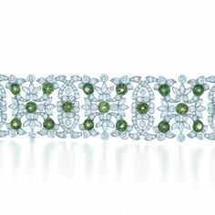 Bracelet of 30 round tsavorites with round and marquise diamonds.