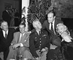 Great shot of Marilyn and Joe DiMaggio having fun at a party at Bob Hope's home on December 13, 1953.