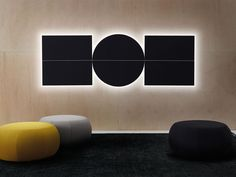 Modern acoustic panels from Arper Parentesit with ambient lighting and speakers