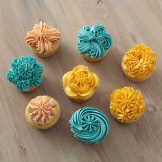 With just a single tip style and a few simple decorating techniques up your sleeve, a myriad of cupcakes are possible. Here a drop flower tip and three vibrant colors of icing create seven impressive cupcake designs perfect for any occasion. Cupcakes Design, Fancy Cupcakes, Decorate Cupcakes, Cake Designs, Flower Cupcakes, Chocolate Buttercream Frosting, Cupcake Frosting, Cupcake Cakes, Cupcake Ideas