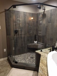 Pebble floors, wood plank shower titles done w/ lighter colored title.  Shower seat idea; master bath