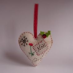sweet felt Christmas heart ornament, by Roxy Creations Christmas Sewing, Handmade Christmas, Christmas Diy, Christmas Cross, Felt Christmas Decorations, Felt Christmas Ornaments, Christmas Projects, Holiday Crafts, Fabric Hearts