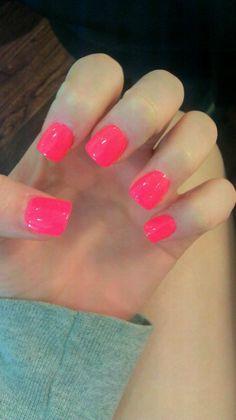 Pink square nails.