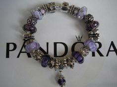 http://www.ebay.com/itm/Gorgeous-Pandora-Embossed-Bracelet-Purple-Murano-Glass-Beads-Silver-Charms-/300701172680?pt=Designer_Jewelry=item46032fc3c8#ht_1054wt_1482