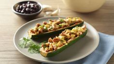"""Scoop out the seeds from zucchinis and use them as """"boats"""" for a new spin on enchiladas."""