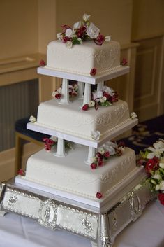wedding cakes with pillars and roses monogrammed wedding cake with glass pillars filled with 26080
