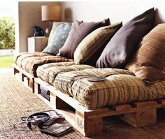 Wood pallet couch with big pillows and comfy cushions - I have lots of huge floor cushions! and two mattresses... floor cushions for the seats, mattreses for the back rest?