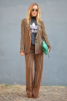 Street Style Inspiration for Wearing a Slogan Tee | @adidas t-shirt paired with orange and black striped suit