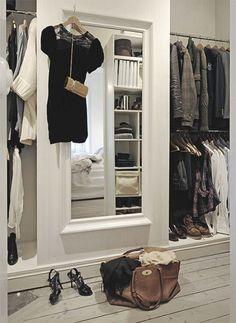 Minimalist black & white closet. Gorgeous. Keep your closet looking organized with Bag Beautiful.     bagbeautiful.com