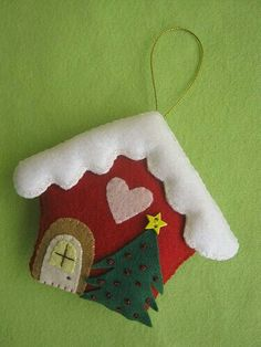 felt house ornament - image only Felt Christmas Decorations, Felt Christmas Ornaments, Christmas Fun, Christmas Houses, Christmas Projects, Felt Crafts, Holiday Crafts, Paper Crafts, Christmas Sewing