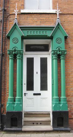 White entry door with emerald green features- beautiful Sculcoates, East Yorkshire, England     .....rh #doors #white #green