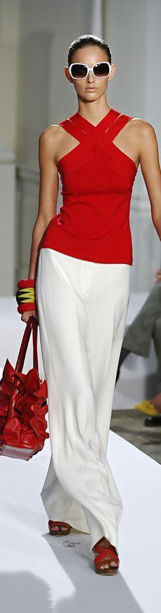 Oscar de la Renta. Love everything but the bangles and handbag. I'd choose a little something different.