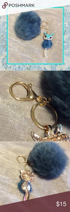 New dark blue fox bling keychain w faux fur Unique Styles Very cute dark blue rhinestone bling Gold key fuzzy faux fur fox cat chain with lobster clasp and soft pom-pom puff ball. No name brand. NWOT Accessories Key & Card Holders