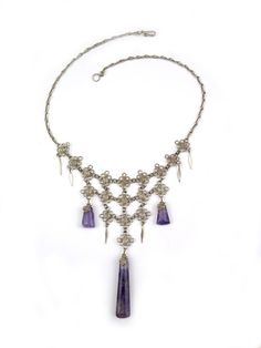 """Wire Wrapped Necklace """"Jaqueline."""" Elegant wire wrap lace brocade necklace with natural amethyst pendants."""