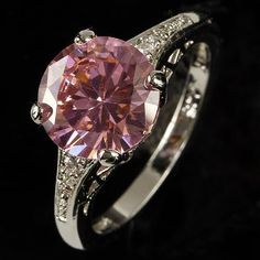 '.925 Stamped Created Pink Topaz Ring Sz. 8' is going up for auction around  11pm EST Thu, Mar 14 with a starting bid of $7.  @Tophatter