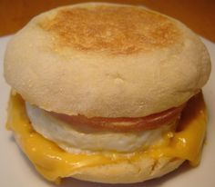 McDonald's Egg McMuffin Recipe  Sandwiches: English muffins; large eggs; cheese; butter or olive oil; muffin tin. Bake eggs in muffin tin @ 350 for 10-15 min. Add grated/shredded cheese to muffin half, cooked egg, and place top half of muffin. (can be frozen, and reheated @ 350 for about 25 min.) gonna try this tomorrow for breakfast!