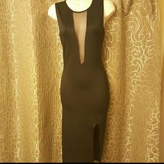 Super sexy cut out midi Sheer details in front and back..mini front/side slit...never worn..NWOT...price is firm Dresses Midi