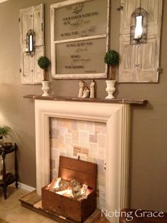 Back your (non-working!) fireplace with some wallpaper -- this blogger chose book pages. #fireplaces #decor