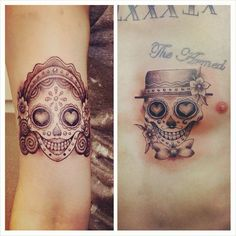 Mine and my partners sugar skull tattoos :)