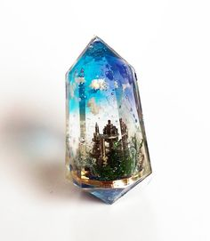 Towering City captured in resin. These UV resin pendants are amazing little works of art. Gem stone with mini city inside Doesn't look crowded, effective having clear parts of the sky. Reminds me of Atlantis. Uv Resin, Resin Art, Diy Resin Crafts, Diy And Crafts, Magical Jewelry, Schmuck Design, Cute Crafts, Totoro, Resin Jewelry
