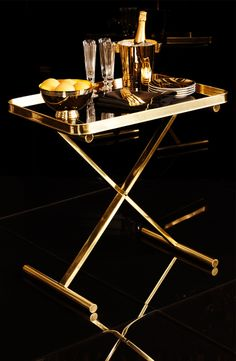 Gold-plated glamour extends to the bar, from Ralph Lauren Home