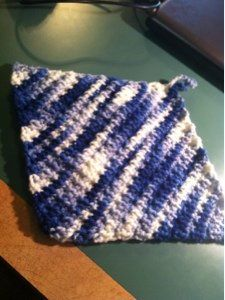 50-Minute Textured Dishcloth - All you need is an hour to work up this crocheted dishcloth. It's worked in four rows with the fourth row repeated until you get the desired length. #Crochet one, today.