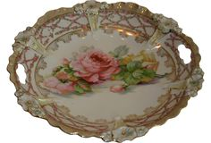 White porcelain two-handled dish with embossed flower accents.