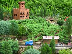 So recently, I went to Walt Disney World.  The above pictures are from the Germany Pavilion in Epcot.  One of the gardens is a miniature village with several LGB trains going around.  Of course, my favorite was the little castle perched on top, looking over everything else.