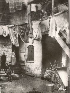 During the 1890s many people in upper- and middle-class society were unaware of the dangerous conditions in the slums among poor immigrants. Jacob Riis, a Danish immigrant who himself could not originally find much work, hoped to expose the squalor of the 19th-century Lower East Side of Manhattan.