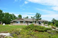 Parry Sound Area:  Ranch Style bungalow sitting on over 3 acres overlooking Georgian Bay.  Some of the features include extensive red granite stonework from a well known craftsmen, oil fired in floor heating, island kitchen, covered sun porch, ensuite bath and much much more.  ANOTHER SOLD!