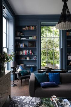 This blue makes the lofty room feel cosy and welcoming. Style ideas from www.californiashutters.co.uk