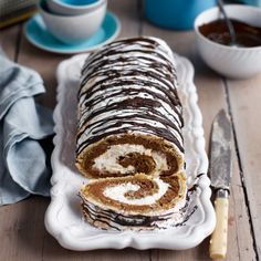 This chocolate hazelnut meringue roulade is filled with a decadent chocolate mousse and dusted with icing sugar. It is set to become a firm family favourite.