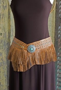 Bandalero Belt made in cowhide embossed with a delicate floral pattern. Belt is finished with pewter buckle, turquoise colored stones and antiqued German silver studs. Wears comfortably on the high hip or low hip. Shown in Tan. Western Belts, Western Wear, Belts For Women, Ladies Belts, Native American Clothing, Romantic Outfit, Hippie Outfits, Leather Fringe, Turquoise Color