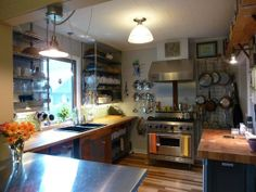 Ron's 'Wonderful Industrial Vibe' Kitchen  Small Cool Kitchens 2013  I am loving the pot hanging on the back wall. Could maybe accomplish with sections of those wire cubes I have a ton of...