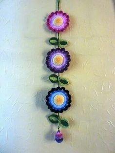 Crochet Flowers Design Ravelry: Colourful Flower Hanging pattern by Janet McMahon - Crochet Bunting, Crochet Garland, Crochet Mandala Pattern, Crochet Curtains, Crochet Decoration, Crochet Flower Patterns, Crochet Designs, Flower Decoration, Crochet Wall Art