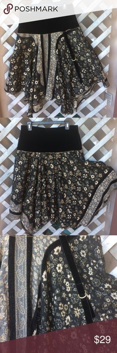 """MULTI PRINT SKIRT BY CHOCOLAT OF NEW ZEALAND! Sooo much style in one skirt!!!! 7"""" velvet waistband tops off MULTI print FLORAL and paisley print -SOFT/STRETCHY  WITH BLACK TRIM thru out print- velvet side sash with buckle! Pretty golden top stitching! WOOL/acrylic/ viscose & spandex! Great with boots& a sweater! Handkerchief hem. CHOCOLAT Skirts"""