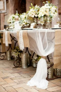 a white cloth like that for the table...but the legs are still visible. so longer and more un-see-thru  tablescape