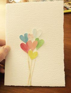 Biglietto d'auguri con cuoricini colorati in rilievo