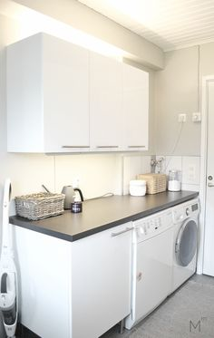 Laundry room's makeover reveal, client project after the makeover. Interior design by Marika Ritala-Mäkinen.
