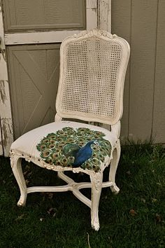 I painted, aged and stained the wood   and then painted the peacock on muslin sheets.      I upholstered the seat with the art work and then stitched out in red thread,