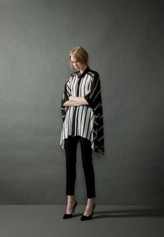 Women's black and white striped dolman sleeved hi-lo shirt and straight black ankle pants
