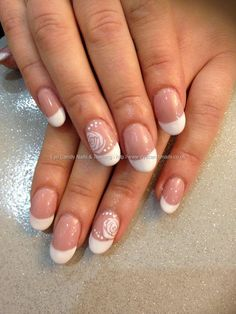 Acrylic ovals with blush gel polish and gel French white with freehand roses nail art.
