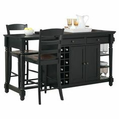 "A prep station, dining area, and storage unit in one, this versatile kitchen island comes with ample cabinet space and 2 complementing barstools.  Product: 1 Kitchen island and 2 barstoolsConstruction Material: WoodColor: Black and rustic cherryFeatures:  Three fixed shelvesTwo cabinet doors on each sideWine rack on each side One towel rack Two pull-through drawers  Dimensions: Kitchen Island: 36"" H x 48"" W x 25"" DBarstool: 41"" H x 17.75"" W x 20.5"" D each"