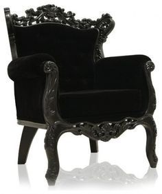 Luxurious Black velvet and wood framed chair by Modani.