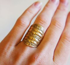 A kalevala koru shield ring, bronze plated sterlibg silver . Koru jewelry are made using the copies of ancient jewelry. Hallmark KK and made in finland, 925 and finish control mark. Size approx 17mm.