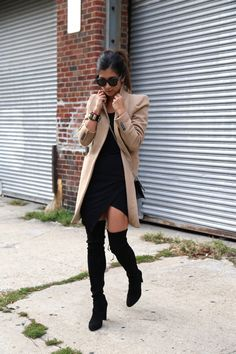 This black wrap around mini dress looks great worn with over the knee boots. Krystal Bick finishes the look with a camel overcoat. Jacket: Zara, Dress: Lovers & Friends, Boots: Stuart Weitzman, Bag: Saint Lauren.