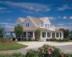 House in Cape Cod with cape front property and lots of vegitation.